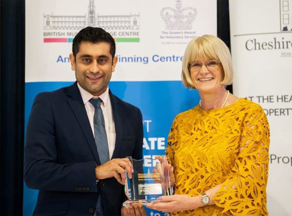 Patsy Kane OBE MA receives an award for contributions to the local community
